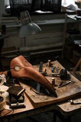 Close-up of Plague Doctor Mask and tools at manufacture of craft leather products