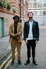 Two stylish yet oppositely dressed men in a street in London