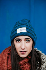 Portrait of a young woman wearing a beanie