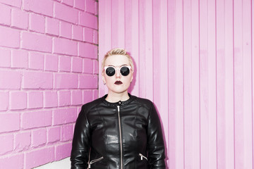 portrait of lesbian woman on the pink background