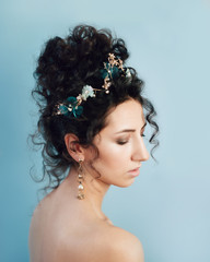 Brunette with blue decorated hairdo