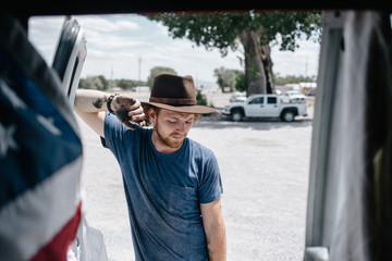 Modern American cowboy outside his van after working