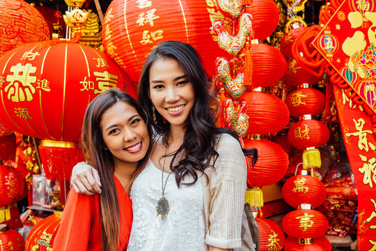 Friends Posing in Front of Many Lanterns