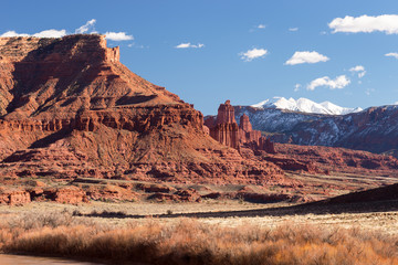 Fisher Towers Recreation site is along Utah`s Scenic Colorado River way into Moab Utah. The Lasal Mountains are a snow covered backdrop to the Fisher Towers.