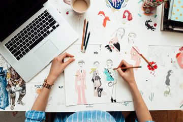 Female Designer Doing Fashion Sketches