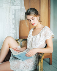 Female sitting on chair reading book