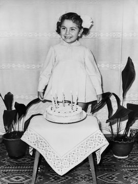Young girl celebrating her fifth birthday in 1970