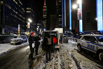 New York City's Coalition for the Homeless delivers food, donated clothing and supplies during winter storm Grayson in New York