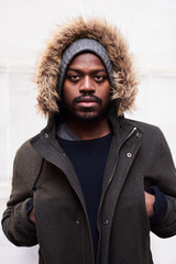 Bearded man in casual hooded jacket.