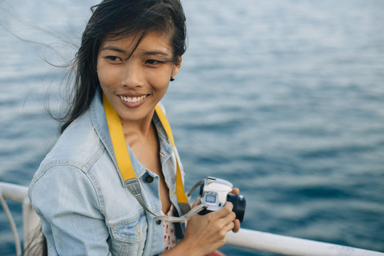 Female photographer on boat