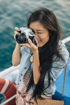 Female photographer on boat