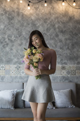 Young asian woman with flowers