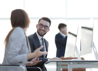prospective employees are talking at their Desk