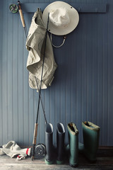 Fishing pole and equipment hanging on hooks