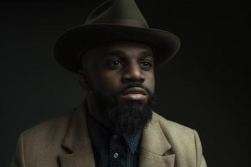 Portrait of hip black man on dark background
