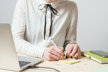 Close Up Of Woman Writing A Note