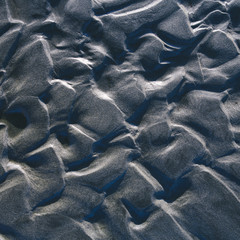 Detail of patterns in sand at low tide