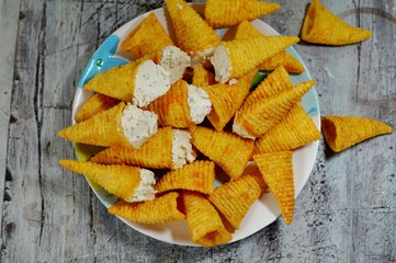 Cones stuffem with cottage cheese with spices - appetizer