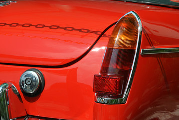 Car tail light or tail lamp. Designed specifically as safety features and indicates the vehicle is braking.