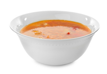 Bowl with tasty lentil soup on white background