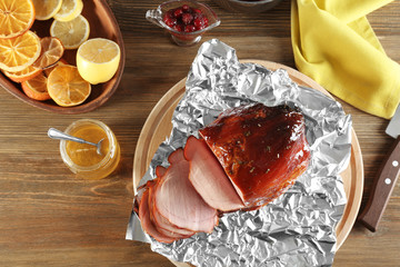 Composition with traditional sliced honey baked ham on table