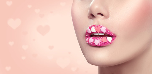 Valentine's Day makeup. Lips with pink hearts sugar sprinkles. Valentine hearts sweet makeup