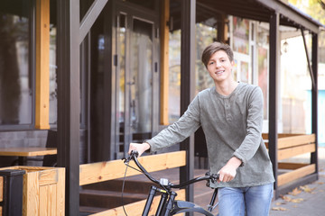 Hipster teenager with bicycle outdoors