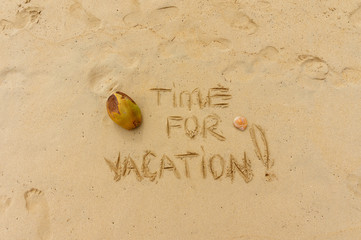 exotic vacation. Time for vacation written on the sand
