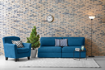 Modern living room interior with comfortable couch and armchair