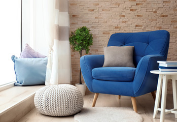 Fototapeta Interior of living room with comfortable armchair obraz