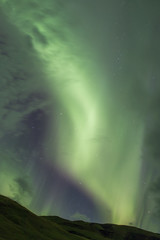 Bright Northern Lights Streaking Across Night Sky