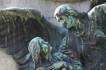Statue of a celestial being/ Angel looking upon a human. Dresden, Grmany, Johannisfriedhof