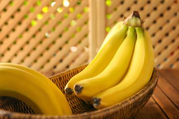 Ripe bananas in wicker basket