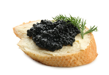 Bread with black caviar and butter on white background
