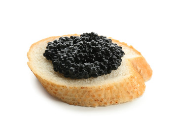 Bread with black caviar on white background