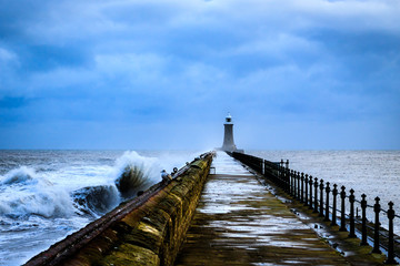 sea defence pier being battered by waves