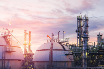 Gas storage spheres tank in oil refinery plant on sky sunset background