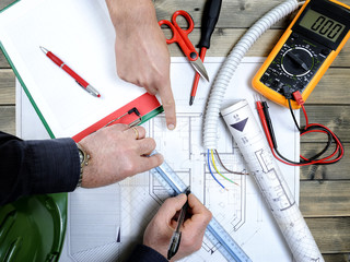 Architect and technician analyze the project of a residential house