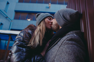 Man and woman kissing in street. Close-up.
