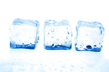 Blue ice cubes on white background.