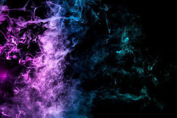 Colorful smoke of blue, pink, green on a black isolated background. Background from the smoke of wipe