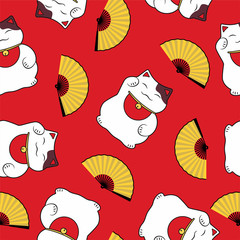 seamless pattern of a traditional cute luck symbol of a cat maneki neko and an open fan on a red background