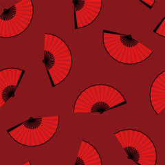 seamless pattern of an open traditional Japanese fan on a red background