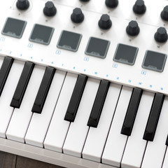 MIDI keyboard with pads and faders.