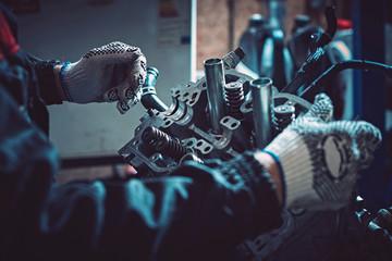 Closeup repair of an opposing engine by an auto mechanic.