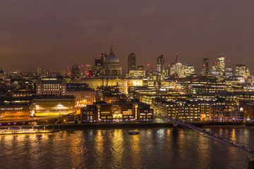 Financial Business Center Cityscape And River Thames At Night  In London, UK.