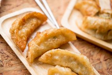 Gyoza dumplings in wooden plate