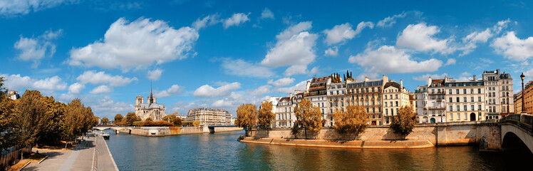 Fototapete - Paris, panorama over river Seine with Notre-Dame cathedral in Fall