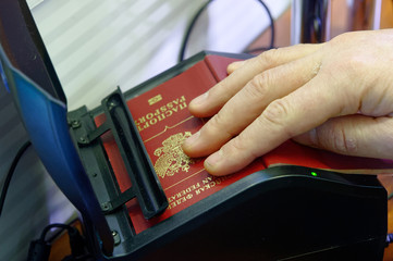Scanning a Russian passport for border control at the Ukrainian checkpoint