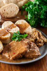 Pork loin in gravy with bread dumplings and sauerkraut